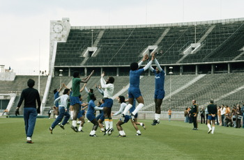 Mario Zagallo the coach for Brazil and the team trainer Admillo Chirol watch as Jairzinho and Marco Antonio in the foreground with the rest of the squad in training before the start of the 1974 FIFA World Cup in June 1974 at the Berlin Olympic Stadium in