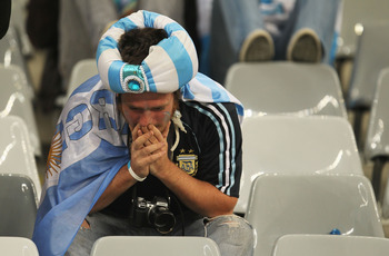 CAPE TOWN, SOUTH AFRICA - JULY 03:  A dejected Argentina fan after being knocked out of the competition following the 2010 FIFA World Cup South Africa Quarter Final match between Argentina and Germany at Green Point Stadium on July 3, 2010 in Cape Town, S