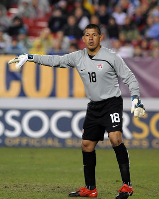 TAMPA - FEBRUARY 24: Goal keeper Nick Rimando #18 of the U. S. Men's Soccer Team directs play against El Salvador February 24, 2010 at Raymond James Stadium in Tampa, Florida. (Photo by Al Messerschmidt/Getty Images)