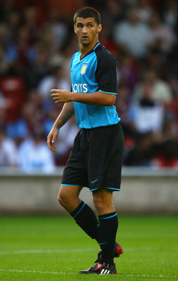 WALSALL, UNITED KINGDOM - JULY 22:  Eric Lichaj of Aston Villa in action during the Pre Season Friendly match between Walsall and Aston Villa at the Bescot Stadium on July 22, 2008 in Walsall, England.  (Photo by Paul Gilham/Getty Images)