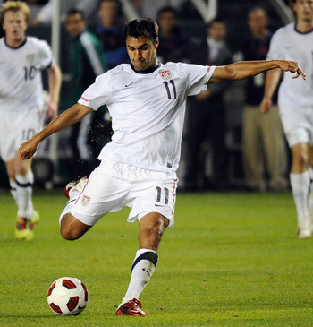 CARSON, CA - JANUARY 22:  Chris Wondolowski #11 of the United Statestakes a shot on goal against Francisco Silva #6 of Chile during the friendly soccer match at The Home Depot Center on January 22, 2011 in Carson, California.  (Photo by Kevork Djansezian/