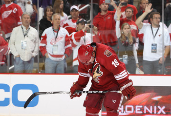 GLENDALE, AZ - APRIL 20:  Shane Doan #19 of the Phoenix Coyotes reacts after being defeated by the Detroit Red Wings in Game Four of the Western Conference Quarterfinals during the 2011 NHL Stanley Cup Playoffs at Jobing.com Arena on April 20, 2011 in Gle