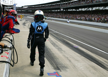 INDIANAPOLIS, IN - MAY 25:  Danica Patrick driver of the #7 Andretti Green Racing Motorola Dallara Honda walks towards pit box of Ryan Briscoe driver of the #6 Team Penske Dallara Honda after crashing with Briscoe during the IRL IndyCar Series 92nd runnin