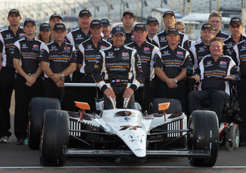 INDIANAPOLIS, IN - MAY 22:  Alex Tagliani of Canada, driver of the #77 Bowers & Wilkins/Sam Schmidt Motorsports Dallara Honda, poses on the finish line after qualifying on the pole for the Indianapolis 500 on May 22, 2011 at Indianapolis Motor Speedway in