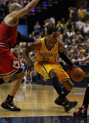 INDIANAPOLIS, IN - APRIL 23: Danny Granger #33 of the Indiana Pacers drives past Carlos Boozer #5 of the Chicago Bulls in Game Four of the Eastern Conference Quarterfinals in the 2011 NBA Playoffs at Conseco Fieldhouse on April 23, 2011 in Indianapolis, I
