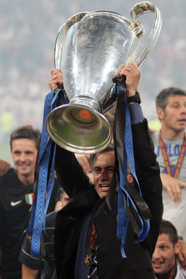 MADRID, SPAIN - MAY 22:  Head coach Jose Mourinho of Inter Milan lifts the UEFA Champions League trophy following their team's victory at the end of the UEFA Champions League Final match between FC Bayern Muenchen and Inter Milan at the Estadio Santiago B