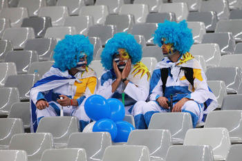 CAPE TOWN, SOUTH AFRICA - JULY 06:  Uruguay show their dejection after suffering defeat in the 2010 FIFA World Cup South Africa Semi Final match between Uruguay and the Netherlands at Green Point Stadium on July 6, 2010 in Cape Town, South Africa.  (Photo