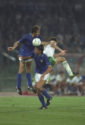30 Jun 1990:  Franco Baresi (top left) and De Agostini (centre) both of Italy win the ball away from John Aldridge (right) of the Republic of Ireland during the World Cup Quarter Final match in Rome. Italy won the match 1-0. \ Mandatory Credit: David  Can