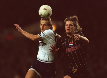 10 DEC 1994:  JURGEN KLINSMANN OF TOTTENHAM BEATS ANDY PEARCE OF SHEFFIELD WEDNESDAY TO SCORE IN THEIR FA PREMIERSHIP MATCH TODAY. TOTTENHAM HOTSPURS WON THE MATCH 3-1. PHOTO: MIKE COOPER/ALLSPORT. Mandatory Credit: Mike Cooper/ALLSPORT