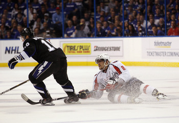 TAMPA, FL - MAY 03: Alex Ovechkin #8 of the Washington Capitals loses an edge against the Tampa Bay Lightning in Game Three of the Eastern Conference Semifinals during the 2011 NHL Stanley Cup Playoffs at St Pete Times Forum on May 3, 2011 in Tampa, Flori
