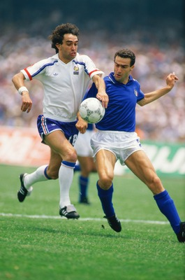 17 Jun 1986:  Dominique Rocheteau of France takes on Guiseppe Bergomi of Italy during the World Cup match in Mexico City. France won the match 2-0. \ Mandatory Credit: David  Cannon/Allsport