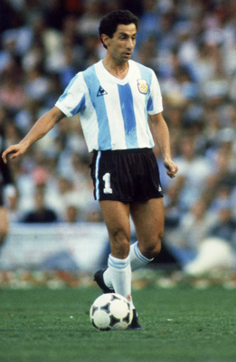 BARCELONA - JUNE 13:  Ossie Ardiles of Argentina runs with the ball during the FIFA World Cup Finals 1982 Group C match between Argentina and Belgium held on June 13, 1982 at the Nou Camp, in Barcelona, Spain. Belgium won the match 1-0. (Photo by Steve Po
