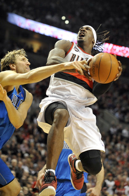 PORTLAND, OR - APRIL 28: Gerald Wallace #3 of the Portland Trail Blazers is fouled by Dirk Nowitski #41 of the Dallas Mavericks during the fourth quarter of Game Six of the Western Conference Quartefinals in the 2011 NBA Playsoffs on April 28, 2011 at the