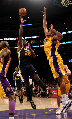 LOS ANGELES, CA - APRIL 5:  Al Jefferson #25 of the Utah Jazz shoots over Andrew Bynum #17 of the Los Angeles Lakers at Staples Center on April 5, 2011 in Los Angeles, California.  NOTE TO USER: User expressly acknowledges and agrees that, by downloading