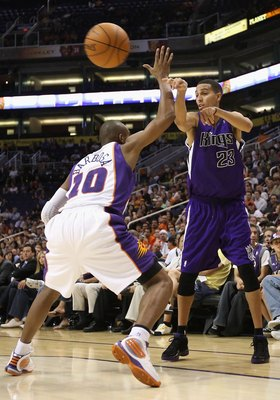 PHOENIX - OCTOBER 20:  Kevin Martin #23 of the Sacramento Kings passes the ball under pressure from the Phoenix Suns during the NBA preseason game at US Airways Center on October 20, 2009 in Phoenix, Arizona. The Suns defeated the Kings 143-127.  NOTE TO