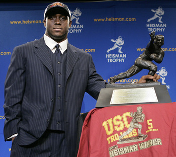 NEW YORK - DECEMBER 10:  Running back Reggie Bush #5 of the USC Trojans poses with the 2005 Heisman trophy after winning the award at the 71st Annual Heisman Ceremony on December 10, 2005 in New York City.  (Photo by Stephen Chernin/Getty Images)