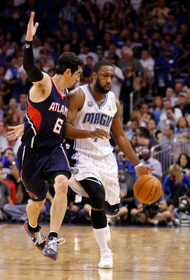 ORLANDO, FL - APRIL 26:  Gilbert Arenas #1 of the Orlando Magic drives past Kirk Hinrich #6 of the Atlanta Hawks during Game Five of the Eastern Conference Quarterfinals of the 2011 NBA Playoffs on April 26, 2011 at the Amway Arena in Orlando, Florida.  N