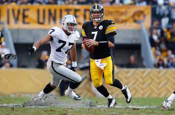 PITTSBURGH, PA - NOVEMBER 21:  Ben Roethlisberger #7 of the Pittsburgh Steelers runs out of the pocket from Matt Shaughnessy #77 of the Oakland Raiders during the game on November 21, 2010 at Heinz Field in Pittsburgh, Pennsylvania.  (Photo by Jared Wicke