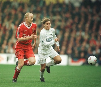 10 Mar 1996:  Mark Wright of Liverpool battle with Tomas Brolin of Leeds during the Leeds United v Liverpool FA Cup Quarter Final match at Elland Road, Leeds. Mandatory Credit: Clive Brunskill/ALLSPORT
