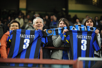 MILAN, ITALY - APRIL 16: Fans of FC Internazionale MIlano hold up shirts of former player Giacinto Facchetti, during the Serie A match between FC Internazionale Milano and Juventus FC at Stadio Giuseppe Meazza on April 16, 2010 in Milan, Italy.  (Photo by