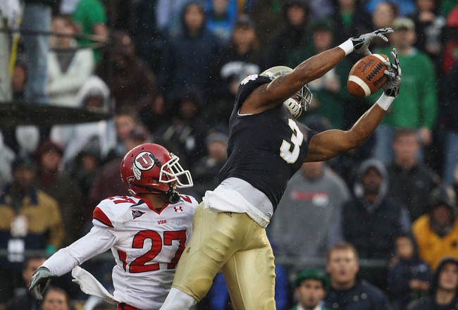 SOUTH BEND, IN - NOVEMBER 13: Michael  Floyd #3 of the Notre Dame Fighting Irish catches a touchdown pass over Brandon Burton #27 of the Utah Utes at Notre Dame Stadium on November 13, 2010 in South Bend, Indiana. (Photo by Jonathan Daniel/Getty Images)