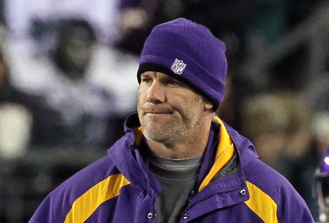 PHILADELPHIA, PA - DECEMBER 28:  Injured Quarterback Brett Favre #4 of the Minnesota Vikings stands on the field during thier game against the Philadelphia Eagles at Lincoln Financial Field on December 26, 2010 in Philadelphia, Pennsylvania.  (Photo by Ji