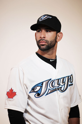 DUNEDIN, FL - FEBRUARY 20:  (EDITORS NOTE : THIS IMAGE HAS BEEN DIGITALLY DESATURATED). Jose Bautista #19 of the Toronto Blue Jays poses during photo day at Florida Auto Exchange Stadium on February 20, 2011 in Dunedin, Florida.  (Photo by Nick Laham/Gett