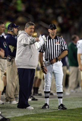 PALO ALTO, CA - NOVEMBER 28:  Notre Dame head coach Charlie Weis speaks to a referee during their game against the Stanford Cardinal at Stanford Stadium on November 28, 2009 in Palo Alto, California.  (Photo by Ezra Shaw/Getty Images)