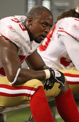 MINNEAPOLIS - SEPTEMBER 27: Manny Lawson #99 of the San Francisco 49ers sits on the bench at the end of a game against the Minnesota Vikings at the Hubert H. Humphrey Metrodome on September 27, 2009 in Minneapolis, Minnesota. The Vikings defeated the 49er