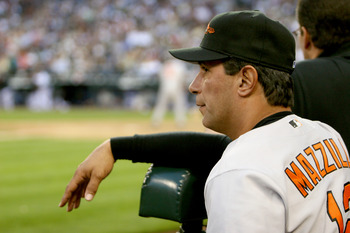 SEATTLE - JULY 14:  Manager Lee Mazzilli #12 of the Baltimore Orioles watches the game against the Seattle Mariners on July 14, 2005 at Safeco Field in Seattle Washington. The Orioles won 5-3.  (Photo by Otto Greule Jr/Getty Images)