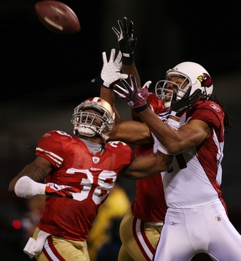SAN FRANCISCO - DECEMBER 14:  Wide receiver Larry Fitzgerald #11 of the Arizona Cardinals goes up for a catch as it is broken up by Dashon Goldson #38 of the San Francisco 49ers in the first half at Candlestick Park on December 14, 2009 in San Francisco,