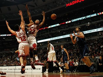 CHICAGO - MARCH 09: Deron Williams #8 of the Utah Jazz passes the ball to teammate Mehmet Okur #13 between Kirk Hinrich #12 and Taj Gibson #22 of the Chicago Bulls at the United Center on March 9, 2010 in Chicago, Illinois. NOTE TO USER: User expressly ac