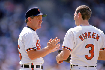 1990:  Coach Johnny Oates of the Baltimore Orioles talks to pitcher Billy Ripken #3 during a game in the 1990 season. (Photo by: Rick Stewart/Getty Images)