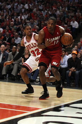CHICAGO, IL - MAY 18: Mario Chalmers #15 of the Miami Heat drives past C.J. Watson #32 of the Chicago Bulls in Game Two of the Eastern Conference Finals during the 2011 NBA Playoffs on May 18, 2011 at the United Center in Chicago, Illinois. The Heat won 8
