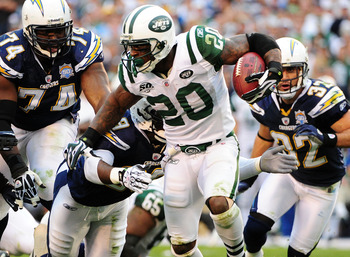 SAN DIEGO - JANUARY 17:  Running back Thomas Jones #23 of the New York Jets runs with the ball against the San Diego Chargers during the AFC Divisional Playoff Game at Qualcomm Stadium on January 17, 2010 in San Diego, California.  (Photo by Robert Laberg