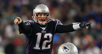 FOXBORO, MA - JANUARY 16:  Quarterback Tom Brady #12 of the New England Patriots signals during their 2011 AFC divisional playoff game against the New York Jets at Gillette Stadium on January 16, 2011 in Foxboro, Massachusetts.  (Photo by Elsa/Getty Image
