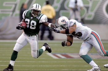 EAST RUTHERFORD, NJ - SEPTEMBER 18:  Running back Curtis Martin #28 of the New York Jets runs the ball against linebacker Junior Seau #55 of the Miami Dolphins on September 18, 2005 at Giants Stadium in East Rutherford, New Jersey. The Jets defeated the D