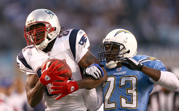 SAN DIEGO - OCTOBER 12:  Wide Receiver Randy Moss #81 of the New England Patriots can't hold onto a pass against Cornerback Quentin Jammer #23 of the San Diego Chargers during the first half of their NFL Game on October 12, 2008 at Qualcomm Stadium in San