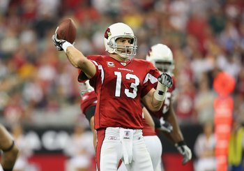 GLENDALE, AZ - JANUARY 10:  Quarterback Kurt Warner #13 of the Arizona Cardinals drops back to pass during the 2010 NFC wild-card playoff game against  the Green Bay Packers at the Universtity of Phoenix Stadium on January 10, 2010 in Glendale, Arizona.