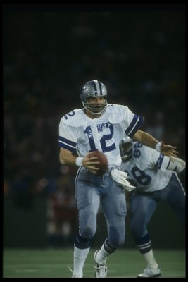 1978:  Quarterback Roger Staubach of the Dallas Cowboys looks to pass the ball during a game. Mandatory Credit: Allsport  /Allsport