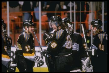 9 Dec 1997:  Right winger Jaromir Jagr of the Pittsburgh Penguins talks to teammate Robert Dome (center) during a game against the Los Angeles Kings at the Great Western Forum in Inglewood, California.  The Penguins won the game 2-1. Mandatory Credit: Els