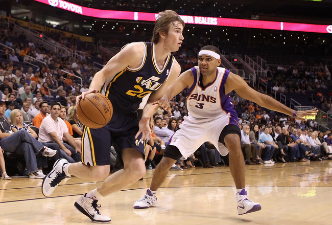 PHOENIX - OCTOBER 12:  Gordon Hayward #20 of the Utah Jazz drives the ball past Jared Dudley #3 of the Phoenix Suns during the preseason NBA game at US Airways Center on October 12, 2010 in Phoenix, Arizona. NOTE TO USER: User expressly acknowledges and a