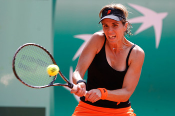PARIS, FRANCE - MAY 22:  Maria Jose Martinez Sanchez of Spain plays a forehand during the women's singles round one match between Shahar Peer of Israel and Maria Jose Martinez Sanchez of Spain on day one of the French Open at Roland Garros on May 22, 2011