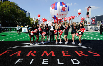 LOS ANGELES, CA - FEBRUARY 01:  Farmers Insurance Exchange executives Paul Patsis (C) with cheerleaders after an event announcing naming rights for the new football stadium Farmers Field at Los Angeles Convention Center on February 1, 2011 in Los Angeles,