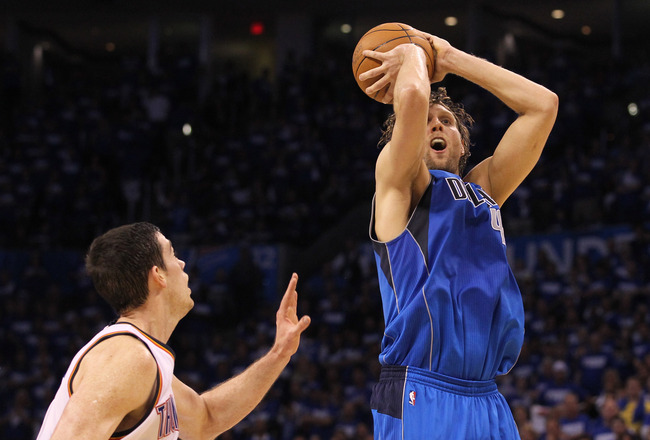 OKLAHOMA CITY, OK - MAY 21:  Dirk Nowitzki #41 of the Dallas Mavericks goes up for a shot against Nick Collison #4 of the Oklahoma City Thunder in Game Three of the Western Conference Finals during the 2011 NBA Playoffs at Oklahoma City Arena on May 21, 2