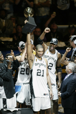 SAN ANTONIO - JUNE 15:  Tim Duncan #21 of the San Antonio Spurs holds up his 2003 NBA Finals MVP (Most Valuable Player) award as the San Antonio Spurs celebrate their NBA Championship after defeating the New Jersey Nets in game six of the 2003 NBA Finals