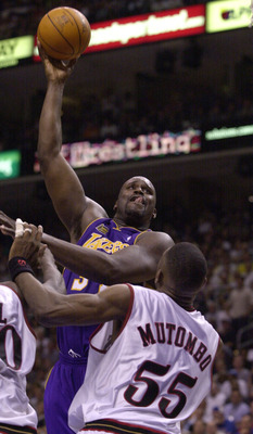 10 Jun 2001:  Shaquille O''Neal #34 of the Los Angeles Lakers shoots a hook shot over Dikembe Mutombo #55 of the Philadelphia 76ers during game 3 of the NBA Finals at the First Union Center in Philadelphia, Pennsylvania.  DIGITAL IMAGE Mandatory Credit: E