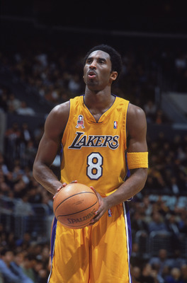 27 Nov 2001:  Kobe Bryant #8 of the Los Angeles Lakers looks to make a free throw during the National Anthem before the game against the Milwaukee Bucks at the STAPLES Center in Los Angeles, California. The Lakers defeated the Bucks 104-85. NOTE TO USER: