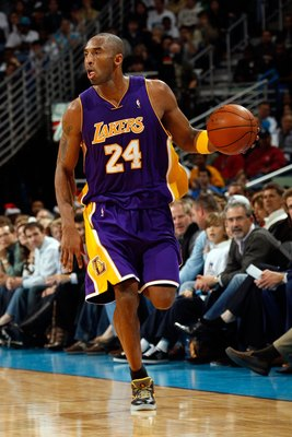 NEW ORLEANS - DECEMBER 23:  Kobe Bryant #24 of the Los Angeles Lakers dribbles against the New Orleans Hornets on December 23, 2008 at the New Orleans Arena in New Orleans, Louisiana.  NOTE TO USER: User expressly acknowledges and agrees that, by download
