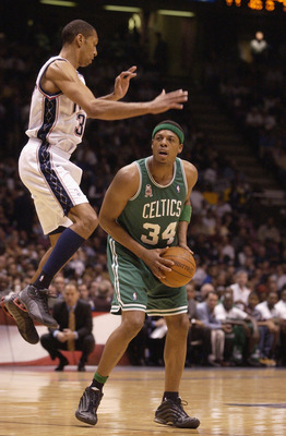 EAST RUTHERFORD, NJ - MAY 21: Paul Pierce #34 of the Boston Celtics avoids Kerry Kittles #30 of the New Jersey Nets in Game two of the Eastern Conference Finals during the 2002 NBA Playoffs at Continental Airlines Arena in East Rutherford, New Jersey on M